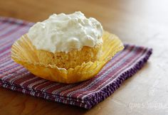 These low fat cupcakes are moist and delicious and you won't believe how easy they are to make. All it takes is a box of yellow cake mix and a can of crushed pineapple; no eggs, no oil or butter needed!!  You can simply eat them with Cool Whip or make them blissful as I did here with my pineapple fluff cream cheese frosting!  I always laugh when I have to come up with names for recipes. I could havce simply called them Pineapple cupcakes, but I think they are so much more with this topping…