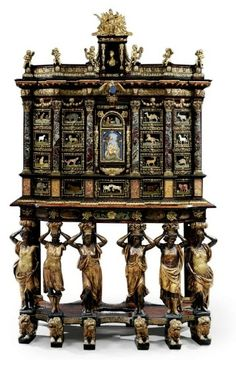 A MAGNIFICENT LOUIS XIV GILT-BRONZE AND PIETRA DURA-MOUNTED BROWN TORTOISESHELL, ASH, EBONISED AND PARCEL-GILT CABINET-ON-STAND ATTRIBUTED TO DOMENICO CUCCI AND THE GOBELINS WORKSHOP, CIRCA 1665-1675  Price Realised  GBP 4,521,250 USD 7,356,074