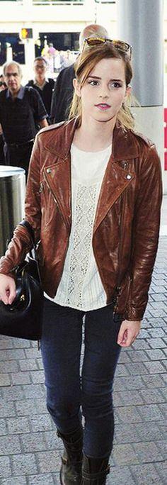 Who made  Emma Watson's black handbag, skinny black jeans, and brown leather jacket?