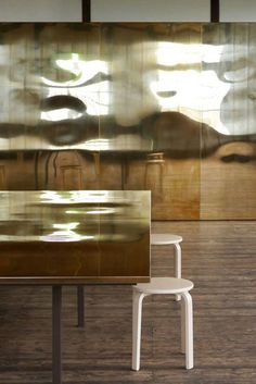 interior by ETAT ARCHITECTS: Library in Awashima. Alvar Aalto stool 60 by Artek. Brass table, brass sheets