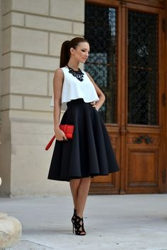 White top with a black flare skirt