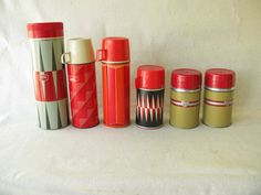 Aren't these FANTASTIC!   Want them all!  Vintage Thermos Your Choice by PassedBy on Etsy