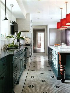 BOB WILLIAMS (of Mitchell Gold + Bob Williams) fabulous retro inspired kitchen. Love the hexagonal marble tiled floor! Laurel home blog. Black cabinets.