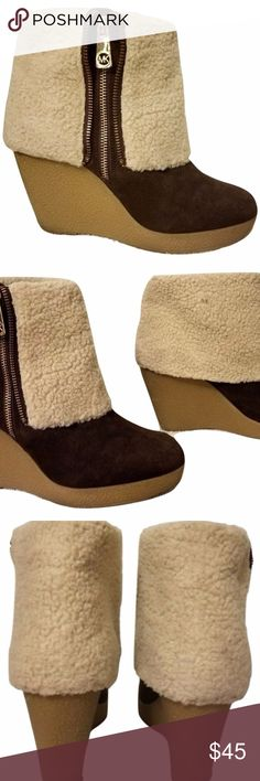 MICHAEL KORS brandy shearling cuff wedge Booties Suede fleece lined boots by MICHAEL Michael Kors. Featuring round toe, zip closure to the side, crepe wedge heel and fleece lining and cuff. ABOUT ME Upper: Leather Lining & Sock: Other materials Sole: Other materials Heel: 4 Inches VERY GOOD gently loved condition. Michael Kors Shoes Ankle Boots & Booties