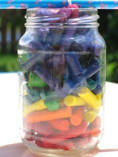 Get a large mason jar, a long skinny candle or just a long wick/waxed string, and all of your broken crayons. Take the mason jar, place the wick in the center ( tie to stick or pencil so it stays in place), then fill the jar with the crayons (make sure the wick still stays centered). Place the jar outside on a hot day and your kids can watch as their old crayons turn into an awesome candle!!!