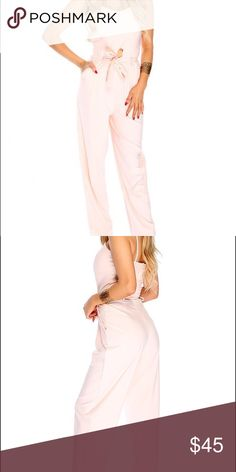 Sexy Front Tie Jumpsuit Peach Jumpsuit features round Neckline, sleeveless, front toe closure, front cutout, back zipper closure 100%Cotton Other
