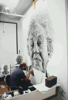 This picture is made of 1000's of fingerprints. Looks like Chuck Close is the artist