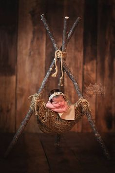 """Love this new prop! Another Original Design from Woodsy Wonders! It's a great size to nestle a newborn into for that sweet loving photo.It comes with a natural colored piece of fleece to keep baby's skin away from the jute nesting. Included is also a bundle of jute twine that you can choose to attach or leave off. Natural Cut Logs Measure approximately 45"""" longWidth of opening approximately 17""""Many thanks to the ever so talented Susan Scott Photography"""