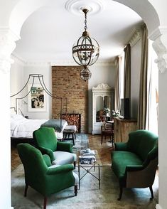 Love the mix of textures in this bedroom. That green velvet seating set is amazing!