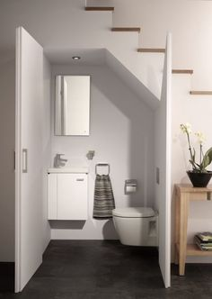 A downstairs WC is a great addition to any home and if space is tight then under the stairs is the ideal place to fit one. Just choose well-designed compact sanitaryware and consult with an FMB-registered plumber on the best way to fit it. Narrower double doors make access easy and won't intrude into narrow hallways. Alternatively a sliding door is a good option. Get the look:Concept Space wall-mounted WC suite, from £335; mirror,from £120; all Ideal Standard