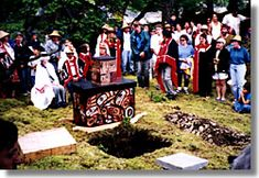 Bill Reid - depositing his ashes in his grave site at .Tanu,  Haida Gwaii  Joanne MacDonald photo.