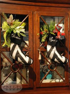 Stockings on cabinet doors. Merry Christmas To All, All Things Christmas, Christmas Home, Christmas Holidays, Christmas Wreaths, Christmas Crafts, Christmas Decorations, Holiday Decorating, Christmas Ideas