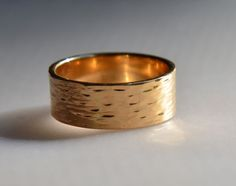 River textured wedding band in 14k yellow gold handmade in Maine.
