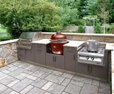 This compact outdoor kitchen layout covers the bases with a grill, smoker and side burner set into Danver stainless steel outdoor cabinetry made to weather the outdoors beautifully.  Contact us for help designing your dream outdoor kitchen.