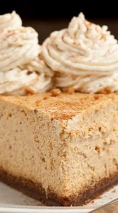 New York Style Pumpkin Cheesecake ~ Every bit as good or better than Cheesecake Factory's seasonal pumpkin cheesecake. NY style Pumpkin Cheesecake that's high, dense, rich, and full of the best fall flavors. On top of a gingersnap crust.