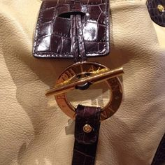 """RALPH LAUREN HANDBAG AUTHENTIC.  RALPH LAUREN leather handbag worn two times and stored away in the closet it is in excellent condition used condition there are no stains or holes come from a smoke free environment.  Beautiful Measurements are 13.5"""" x 9"""" it has two inside pockets and one small zippered interior pocket.  Clasp like closure EQUESTRIAN STYLE.  GOLDTONE hardware. Rich leather.   Creme with chocolate crocodile like leather detail.   NOO DANG TRADES Ralph Lauren Bags Shoulder Bags"""