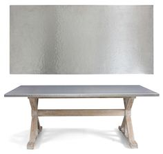 Hammered stainless steel. Use for counters to reflect light and blend carved wood in LR w clean lines of cabinets and table. Would avoid introducing a new material (already in appliances) & therefore increase calmness of kitchen. Easy to clean.