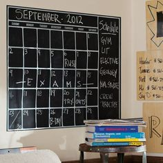A chalkboard calendar for planning out the school week.