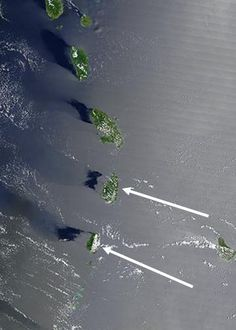 Levitating islands in The Bermuda Triangle observed by satellite? Islands in the Bermuda Triangle were photographed levitating by as much as 10 miles off the surface of the ocean in this recently declassified image from a U.S. spy satellite.  Follow link for story.