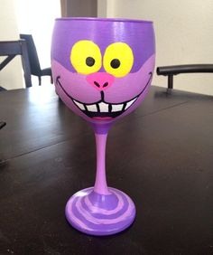 Disney's Cheshire cat inspired hand painted wine glass by kaylieskrafties