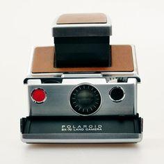 A Polaroid Land Camera. It's the most beautiful Polaroid camera I own. Polaroid Instant Camera, Instant Film Camera, Vintage Polaroid, Vintage Cameras, Retro, Impossible Project, Old Cameras, Polaroid Cameras, Digital Cameras