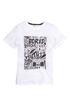 Camiseta con estampado: Camiseta de corte ligeramente largo en punto de algodón con estampado delante.