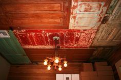 Salvaged doors as ceiling. Would be really cool in an attic or garage space.