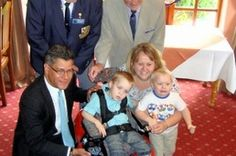 England Lions help present specially designed electric wheelchair to six-year-old boy who cannot walk