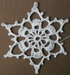big crocheted snowflake - use for a scarf motif or alone for ornament - use soft fuzzy yarn