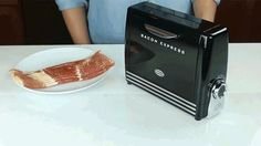 If you find your kitchen counters cluttered with food-specific gadgets and appliances, you finally have a good reason to get rid of them all. The culinary innovators at Nostalgia Electrics have created the only thing you'll ever need: The Bacon Express, a toaster that cooks delicious slices of pork instead of bread.