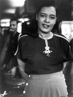 Billie Holiday photographed by Roy DeCarava in 1952 | This is one of the most charming pictures I've seen of her.