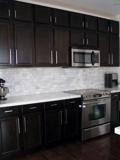 We went for dark wood kitchen designs, and the offer is diversified, so you can pick some of these according to what you wish for for your new kitchen, either built from scratch or that overdue kitchen remodel you have been saving for. Go modern, rustic or minimalist and contemporary, and your kitchen will look great according to our books but remember you have the last saying. The most important part is that among these dark wood kitchen designs you find the kitchen you have been looking… Birch Kitchen Cabinets, Dark Brown Kitchen Cabinets, Backsplash With Dark Cabinets, Brown Kitchens, Home Kitchens, Kitchen Backsplash, Backsplash Ideas, Backsplash Design, White Cabinets
