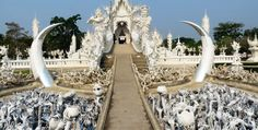 Wat Rong Khun (The White Temple) is a contemporary Buddhist temple situated in Chang Rai, Thailand. It is the vision of artist Chalermchai Kositpipat, who has dedicated the rest of his life to completing the sculpturally intricate, mirror embedded sanctuary.