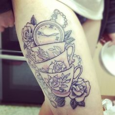 """I'd like this with color, Hatter's hat in there somewhere too, and maybe a potion bottle that says """"drink this"""" and the phrase """"we're all mad here""""..."""