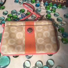 Coach Wristlet Authentic Coach- Sz 6x4- Good condition- Signature C collection- Peach/cream color- Very nice! Coach Bags Clutches & Wristlets