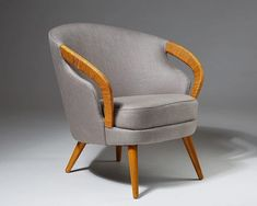 This armchair was designed by Sven Johansson during his time as a cabinet maker for Carl Malmsten.