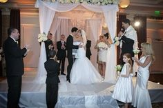 Gorg #canopy wedding alter! Love the personalized floral touch. Great photo via #themodernjewishwedding