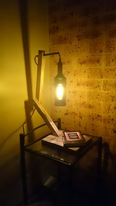Upcycled wood and wine bottle table lamp.