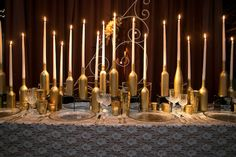I like the bottles as candle holders! Photograph by Bold American Events / NJM Photography