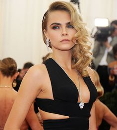 """Cara Delevingne says she'd never let her daughter model because she'd want her to """"use her brain""""."""