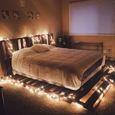 Recycle unused pieces of wood and throw some lighting around to create your own inexpensive yet unique DIY bed. Recycle unused pieces of wood and throw some lighting around to create your own inexpensive yet unique DIY bed. Cute Bedroom Ideas, Room Ideas Bedroom, Bedroom Decor, Bed Ideas, Bedroom Shelves, Bedroom Signs, Kids Bedroom, Master Bedroom, Pallet Bed Frames