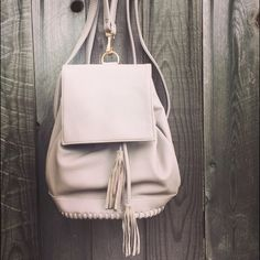 Bohemian Leather Tassel Fringe Backpack Handbag This is genuine leather, it measures 12in. long, it has gold hardware and tassel accents. Bags Backpacks