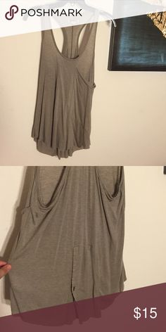 Long Taupe Tank Top Long Taupe Tank Top, great condition, final price, no trades, 15% off bundles of 2+ Quiksilver Tops Tank Tops
