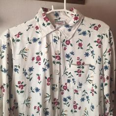 Floral Shirt A nice floral print shirt, in good condition. Has no flaws, says size small but will fit Medium, Large. So cute to wear when your expecting a cute bundle of joyOr when you just want to wear for a night inNot UO. Bundle and save 10%. Free feather necklace with a purchase of $25+ Urban Outfitters Tops Button Down Shirts