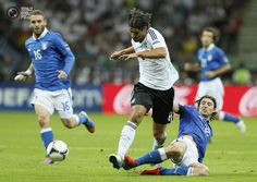 Italy's Montolivo tackles Germany's Khedira during their Euro 2012 semi-final soccer match at National Stadium in Warsaw. PASCAL LAUENER/REUTERS