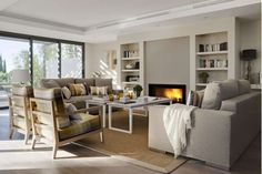 Large living room with built in bookshelves and fireplace