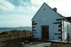 cottage gable with old stone quoins left exposed www. Clare Island, Seaside Cottages, Old Stone, Architects, Ireland, Coastal, Cabin, House Styles, Home Decor