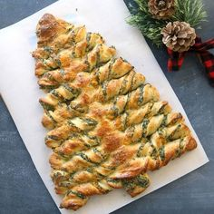 Make this adorable Christmas tree out of spinach stuffed breadsticks! Easy recipe starts with refrigerated pizza dough for a quick holiday appetizer.