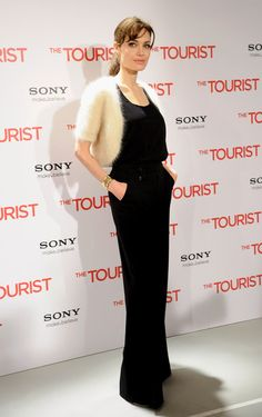 Angelina Jolie wearing the Tiffany & Co. Elsa Peretti 18k yellow gold Bone Cuff at The Tourist photocall in Spain.