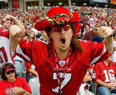 "Arizona Cardinals fan Dustin ""KidStallyn"" Holmes of Tucson cheers during a Cardinals home game. Holmes, a software engineer, says he hasn't missed a Cardinals game since he became a season-ticket holder in 2000."